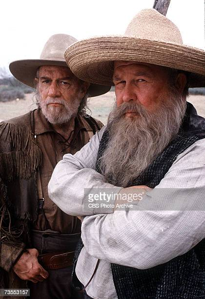 American comedian George Carlin and American actor Ned Beatty pose in character as Billy Williams and Judge Roy Bean respectively on the set of the...