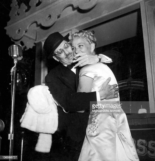 American comedian Groucho Marx embracing actress Betty Hutton circa 1956