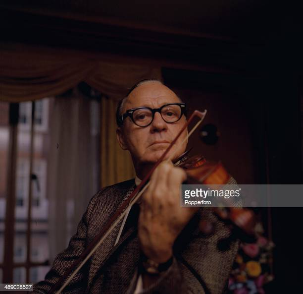 American comedian Jack Benny posed playing a violin in 1967