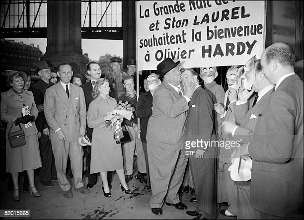 American comedian Oliver Hardy shown in a file photo dated 17 June 1950 kissing his partner Stan Laurel on their arrival at the SaintLazare train...