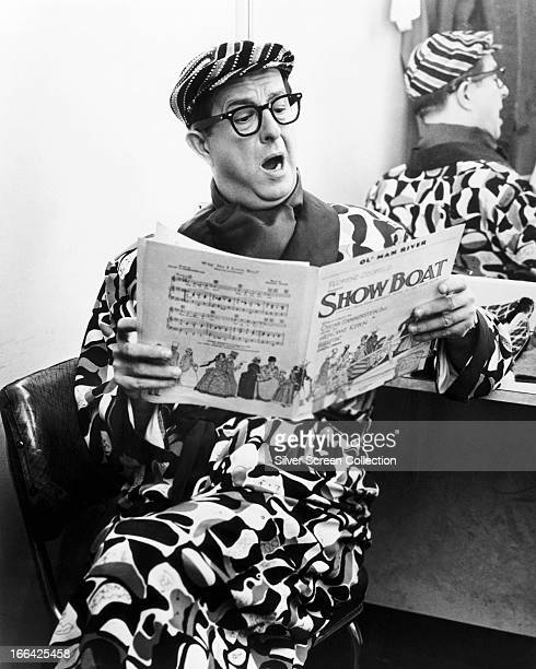 American comedian Phil Silvers singing from the sheet music to 'Showboat' circa 1965