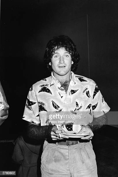 American comedian Robin Williams signs autographs while attending a party to celebrate the success of his television series 'Mork And Mindy' at...