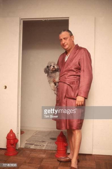 american comedian rodney dangerfield stands in a bathrobe