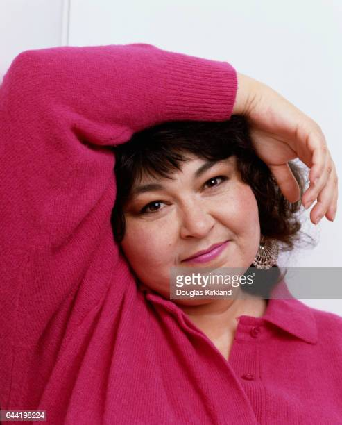 American comedian Roseanne Barr poses with her arm on her head