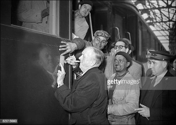 American comedian Stan Laurel shown in a file photo dated 13 April 1950 signing autographs at the SaintLazare train station in Paris