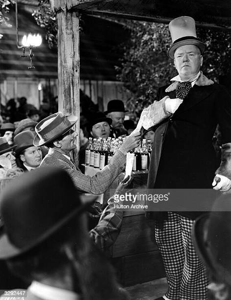 American comedian W C Fields plays itinerant medicine seller Professor Eustace McGargle in the film 'Poppy' directed by A Edward Sutherland for...