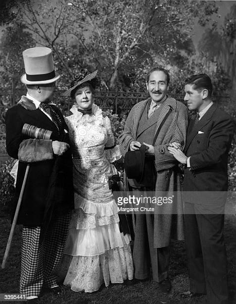 American comedian W C Fields standing with Catherine Doucet Adolphe Menjou and director A Edward Sutherland during production of the Paramount film...