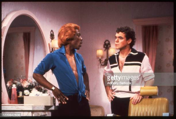 American comedians Eddie Murphy , in costume as the character Dion, and Joe Piscopo, in costume as the character Blaine, perform a skit on an episode...