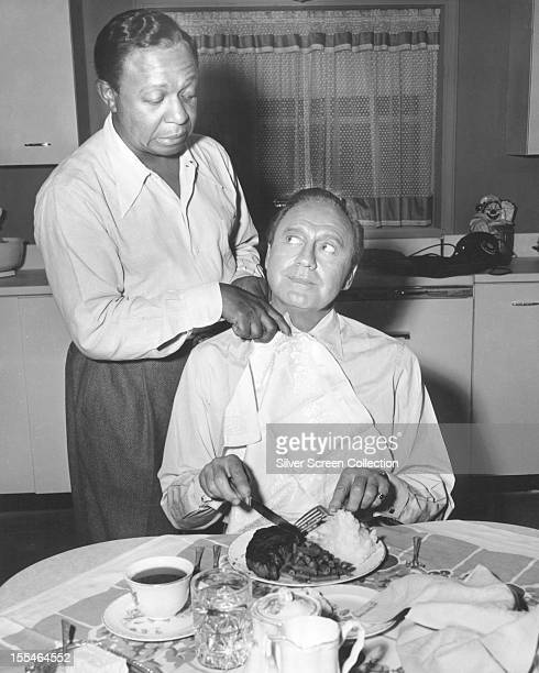American comedians Jack Benny as himself and Eddie Anderson as Benny's valet Rochester van Jones in the US TV comedy series 'The Jack Benny Program'...