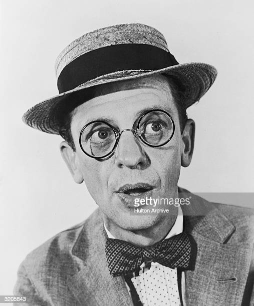 American comedic actor Don Knotts wears a straw hat pincenez glasses and a bow tie in promotional headshot portrait for director Arthur Lubin's film...