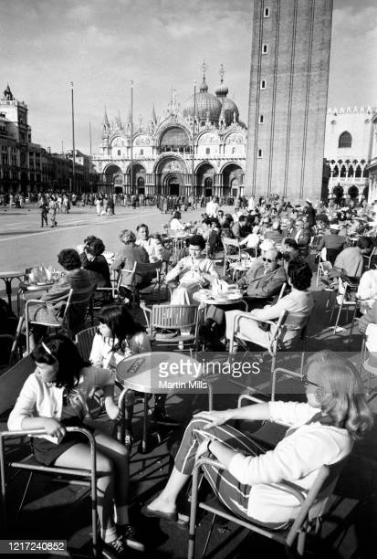 American comedienne, actress, singer and businesswoman Edie Adams , Elizabeth Kovacs and Kippie Kovacs sit at a café in front of St Mark's Basilica...