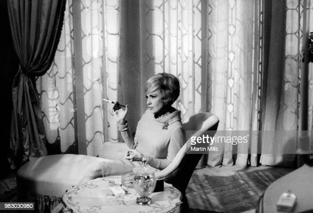 American comedienne actress singer and businesswoman Edie Adams holds a cigar during the filming of 'The Honey Pot' circa 1966 at Cinecitta Studios...