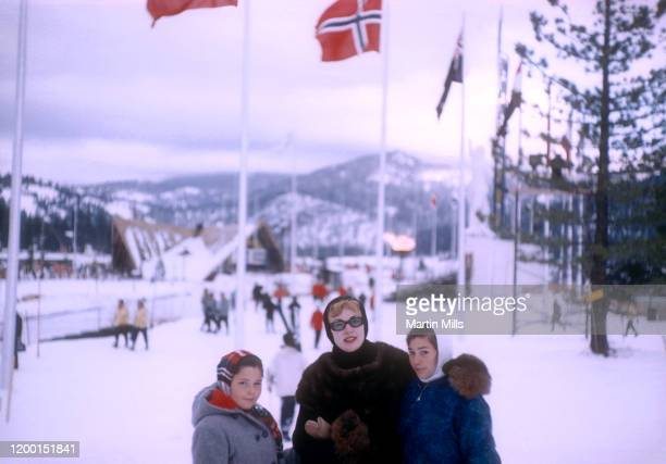 American comedienne actress singer and businesswoman Edie Adams poses with stepdaughters Kippie and Elizabeth Kovacs under the Olympic Cauldron...