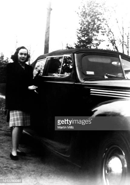 American comedienne, actress, singer and businesswoman Edie Adams poses for a portrait next to her 1940 four-door Packard circa 1944 in Lily Lake,...