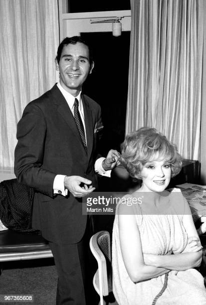 American comedienne actress singer and businesswoman Edie Adams poses for a portrait with her hairdresser circa 1967