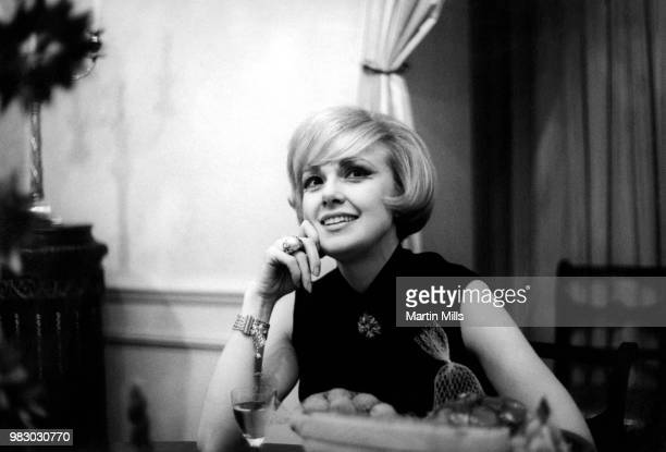 American comedienne actress singer and businesswoman Edie Adams poses for a portrait in her apartment during the filming of 'The Honey Pot' circa...
