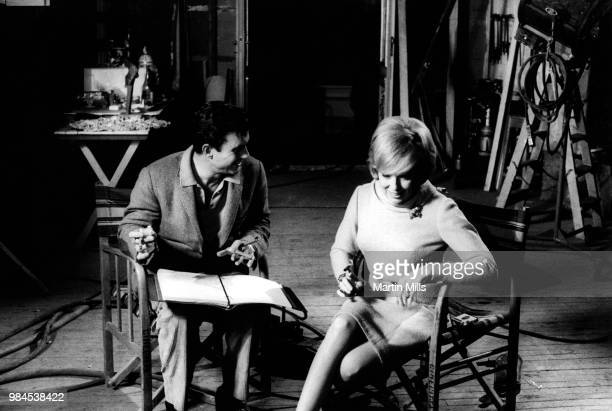 American comedienne actress singer and businesswoman Edie Adams talks backstage with American actor Cliff Robertson during the filming of 'The Honey...