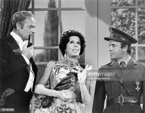 American comedienne and actress Carol Burnett flanked by American comedians Harvey Korman and TIm Conway in a a scene from 'The Carol Burnett Show,'...