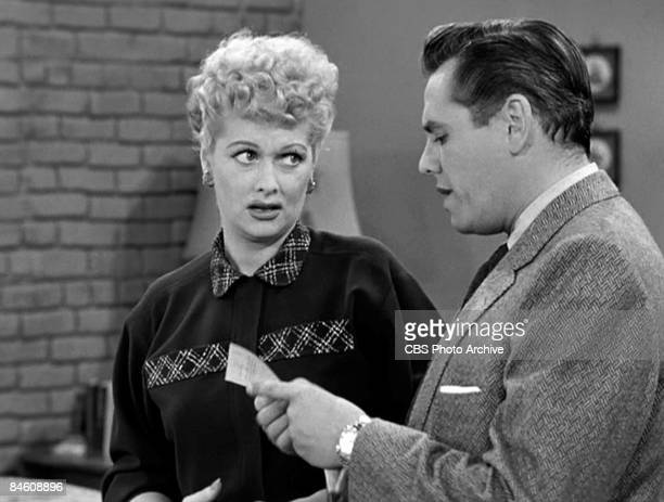 American comedienne and actress Lucille Ball , as Lucy Ricardo, listens to Cuban-born American actor and musician Desi Arnaz , as Ricky Ricardo,...