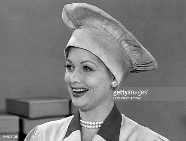 American comedienne and actress Lucille Ball , as Lucy Ricardo, works in a candy factory on an episode of the television comedy 'I Love Lucy'...
