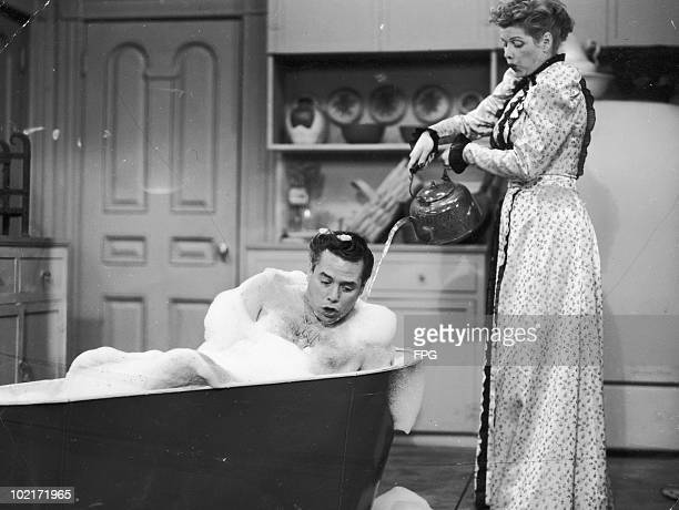American comedienne and actress Lucille Ball with her costar and husband Desi Arnaz in a scene from the American television sitcom 'I Love Lucy'...
