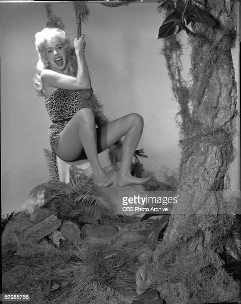 American comedienne Carol Burnett swings on a vine wearing a Tarzan outfit and a blonde wig in a skit from her sketch comedy show The Carol Burnett...
