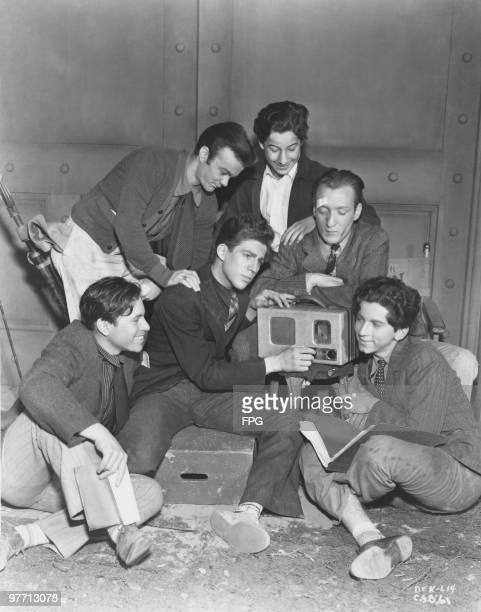American comedy acting team The Bowery Boys listening to a Philco radio circa 1955