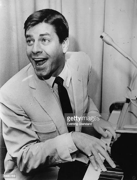 American comedy actor Jerry Lewis with his mouth open at the piano