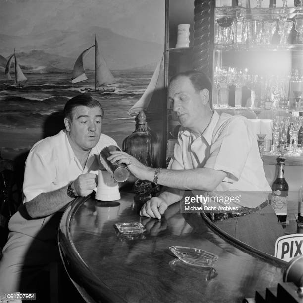 American comedy duo Abbott and Costello at a bar in Los Angeles 1947