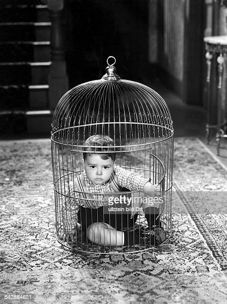 American comedy short films in the 1920/1930ies Scene from the movie 'Our Gang'' Spanky McFarland the boy who is sitting in a gilded cage undated...