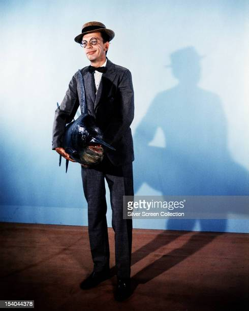 American comic actor Don Knotts as Henry Limpet holding a stuffed swordfish in the liveaction/animated film 'The Incredible Mr Limpet' directed by...