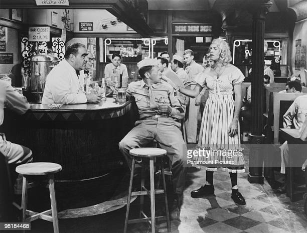 American comic actor Jerry Lewis in drag in a scene from the musical comedy 'At War With The Army' directed by Hal Walker 1950