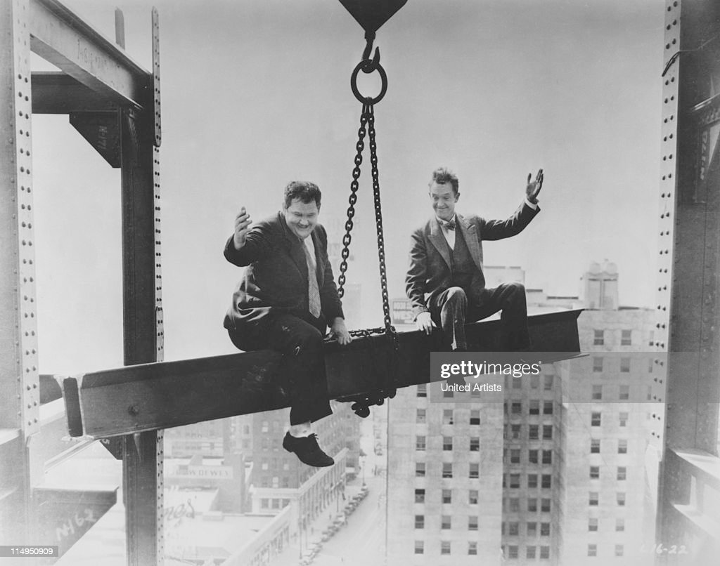 American comic actors Stan Laurel (1890 - 1965, right) and Oliver Hardy (1892 - 1957) in a scene from their film 'Liberty' (aka 'Criminals at Large'), directed by Leo McCarey for Hal Roach Studios, 1929.