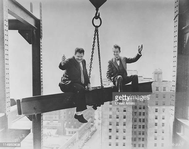 American comic actors Stan Laurel and Oliver Hardy in a scene from their film 'Liberty' directed by Leo McCarey for Hal Roach Studios 1929