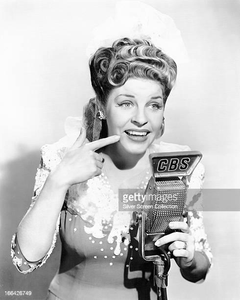American comic actress and singer Martha Raye at a CBS microphone circa 1945