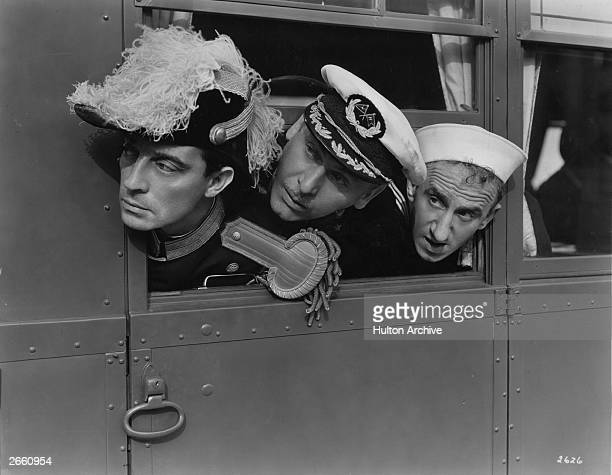 American comics Admiral Buster Keaton Captain Lew Cody and rating Jimmy Durante looking out of Keaton's 'land yacht' which he used as a venue for...