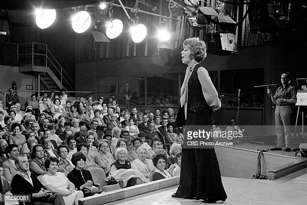 American commedienne and actress Carol Burnett speaks with audience members on an episode of the television comedy variety program 'The Carol Burnett...