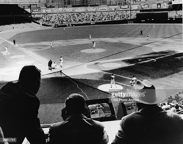American commentators and former baseball players Pee Wee Reese and Dizzy Dean along with an unidentified man broadcast the CBS 'Game of the Week'...