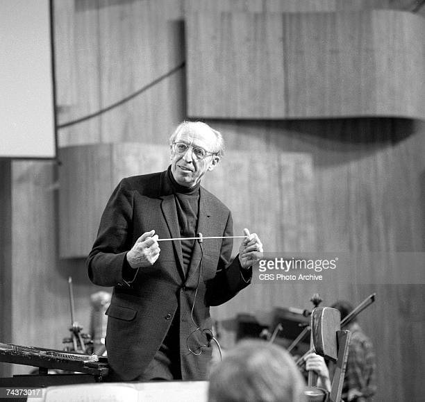 American composer and conductor Aaron Copland holds his baton during rehersals for one of his televised 'Young People's Concerts' featuring the New...
