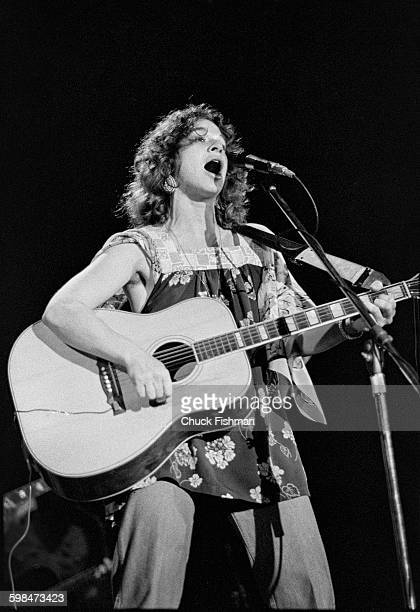 American composer and musician Carole King plays guitar as she performs onstage at Southern Illinois University Carbondale Illinois 1976
