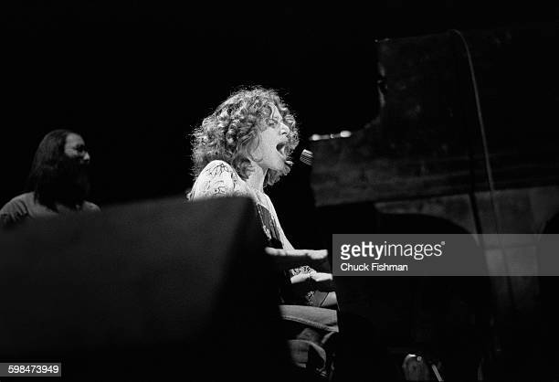American composer and musician Carole King plays piano as she performs onstage at Southern Illinois University Carbondale Illinois 1976