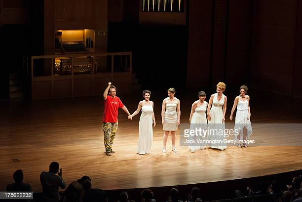 American composer and musician John Zorn takes a bow with singers who had performed his works earlier in the evening from left soprano Jane Sheldon...