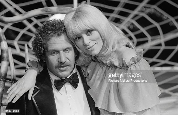 American composer and musician Mort Shuman appears with and French actress Mireille Darc on a television show