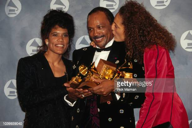American composer and producer Quincy Jones is congratulated by his two daughters Rachel and Tina upon receiving Grammy Awards