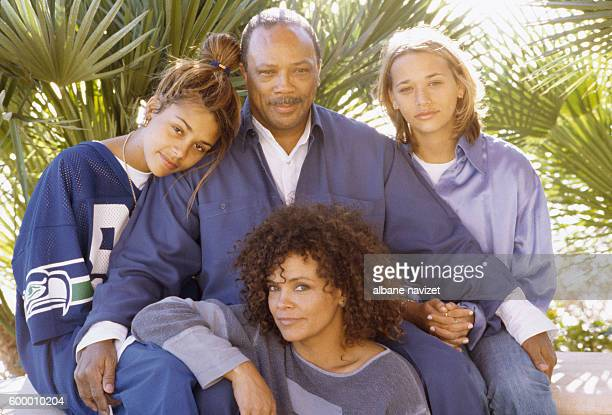 American composer and producer Quincy Jones relaxes with his three daughters Jolie Kidada and Rashida