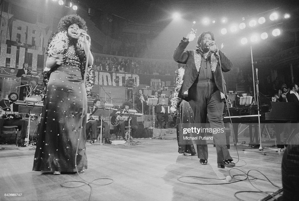American composer and singer-songwriter Barry White (1944 - 2003) performing with The Love Unlimited Orchestra and his female backing vocal trio, Love Unlimited, at the Royal Albert Hall, London, 13th May 1975.