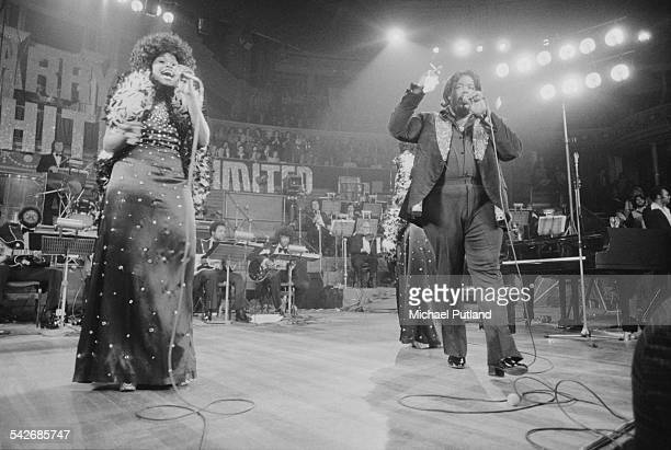 American composer and singersongwriter Barry White performing with The Love Unlimited Orchestra and his female backing vocal trio Love Unlimited at...