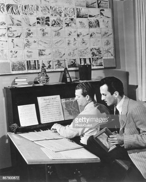 American composer Charles Wolcott plays piano with Brazilian singer Aloysio de Oliveira as they rehearse a song for the Walt Disneyproduced film...