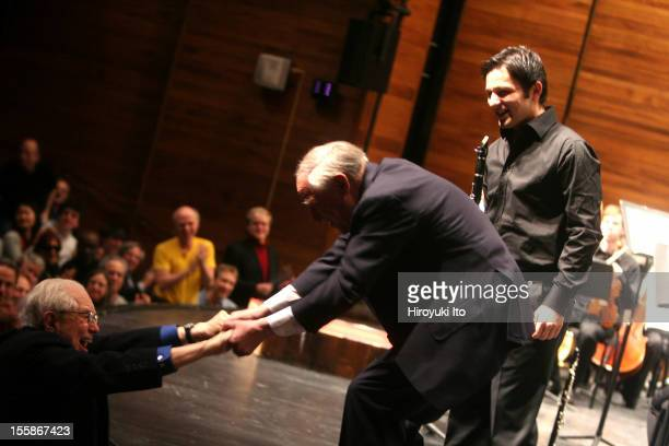 American composer Elliott Carter , greets French composer and conductor Pierre Boulez after Boulez conducted Carter's 'Clarinet Concerto', with...