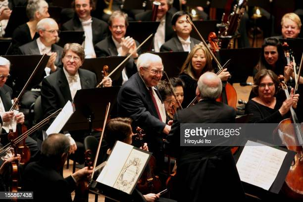 American composer Elliott Carter shakes hands with the concertmaster of the New York Philharmonic Orchestra, Glenn Dicterow, after a performance of...